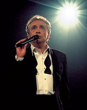 Michel Sardou - Michel Sardou performing in Bercy in 1998