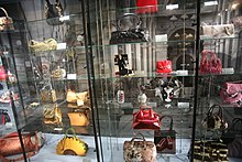 a few purses from the collection on shelves