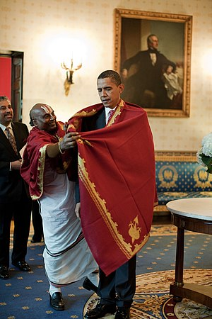 Hinduism in the United States - President of the United States Barack Obama receives a red shawl from a Hindu priest from Sri Siva Vishnu Temple in Lanham, Maryland (October 2009)