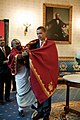 Barack Obama receives a red shawl from Sri Narayanachar Digalakote, a Hindu priest.jpg
