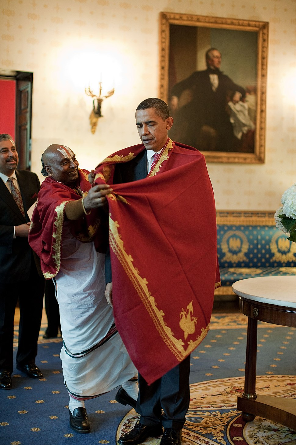 Barack Obama receives a red shawl from Sri Narayanachar Digalakote, a Hindu priest