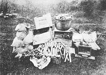 boxes of Pyrotol, sticks of dynamite, sacks of explosives and wiring in a pile