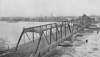 Liberty Bridge (Bay City, Michigan) - Third Street Bridge, the Liberty Bridge's predecessor, with Sage Mill in background, 1918.  The bridge collapsed in 1976 after being hit by a freighter.