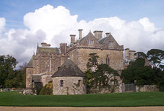 Beaulieu Abbey - The post-Dissolution mansion at Beaulieu, known as Palace House, was built around the mediaeval gatehouse of the abbey (the double gabled building in the centre-right of the picture).