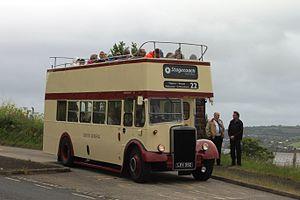 Open top bus - Passengers on board an old Leyland Titan open-top bus view the scenery in Devon.