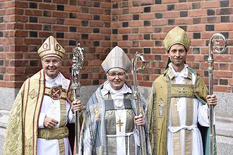 Antje Jackelén - Jackelén (center) as Archbishop of Uppsala on 6 September 2015, with Johan Dalman, Bishop of Strängnäs (left), and Mikael Mogren, Bishop of Västerås (right)