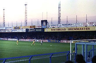 Football hooliganism in the United Kingdom - Hooliganism incidents in the 1970s led to fences being built at football grounds, such as this at Kenilworth Road, Luton (1980 image).
