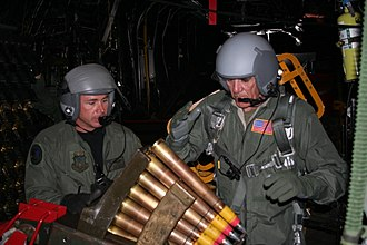 "R. Lee Ermey - Ermey loading ammunition for the Bofors 40 mm gun aboard a Lockheed AC-130H ""Spectre"" Gunship in 2006"