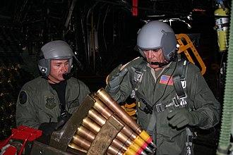 "R. Lee Ermey - Ermey loading ammo for the Bofors 40 mm gun aboard a Lockheed AC-130H ""Spectre"" Gunship in 2006"