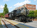 Boston and Maine locomotive No. 410 with caboose (viewed from front right angle); Lowell, MA; 2011-08-20.JPG
