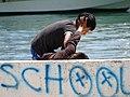 Boys Tussling Above School Graffito - Saranda - Albania (40539180510).jpg
