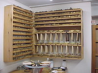 Racks of brass tools and a finishing stove beneath. Brasstools1.jpg