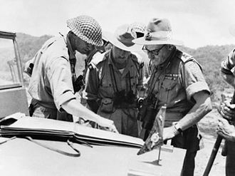 Montagu Stopford - Lieutenant General Montagu Stopford, GOC XXXIII Indian Corps (right), confers with Major General John Grover, GOC 2nd Division (left) and Brigadier Joseph Salomons, commanding the 9th Indian Brigade (centre), after the opening of the Imphal-Kohima road, June 1944.