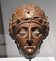 Bronze parade helmet with the face of Amazon from Nola 100-200 AD (51233372856).jpg