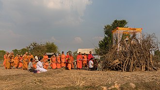 Pyre - Buddhist monks procession in front of a pyre in Laos