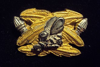 Seabee - WWII Naval Officers assigned to a CB from the Civil Engineer Corps, Medical Corps, Dental Corps and Supply Corps had a silver Seabee on their Corps' insignia.