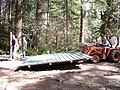 Camp Waskowitz - raising a shelter roof 01.jpg