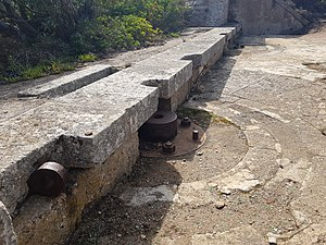 Caprera - Fortification of Poggio Rasu (Caprera, Sardinia). The pedestal was probably used for Hotchkiss 57 mm gun (QF 6-pounder Hotchkiss) or 57/43 Mod. 1887 QF 6 pounder Nordenfelt (both used by the Italian army)