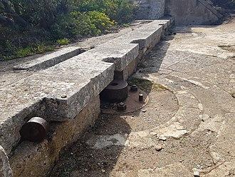Caprera - Fortification of Poggio Rasu (Caprera, Sardinia). The pedestal was probably used for Hotchkiss 57 mm gun (QF 6-pounder Hotchkiss) or 57/43 Mod. 1887 QF 6 pounder Nordenfelt (both used by the Italian army)