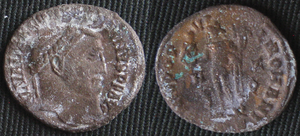 Bronze disease - Unidentified sodium carbonate crystals (white) formed on the same Roman coin treated for bronze disease. The green masses on the coin's reverse are a copper carbonate which formed in the region where the bronze disease was most prevalent. It will be physically removed to ensure that the chlorides have also been removed prior to further conservation efforts. The photos were taken some 20 minutes after rinsing and surface drying.