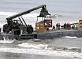 Cargo is unloaded from an improved Navy lighterage system causeway ferry JLOTS 2008 080703-N-1424C-768.jpg