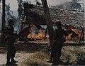 Cavalrymen with burning VC hut, July 1967.jpg