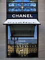 Chanel's headquarters storefront window at the Place Vendôme Paris with awning