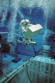 An astronaut in training for an extra-vehicular activity mission using an underwater simulation environment.