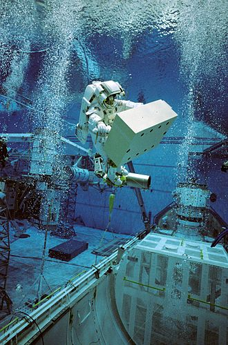 Training - An astronaut in training for an extra-vehicular activity mission using an underwater simulation environment.