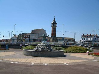 "The centre of Skegness, showing the clock tower and the ""Jolly Fisherman"" sculpture/fountain Clock Tower, Skegness 1.JPG"