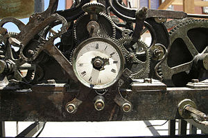 An Old clock with cogs