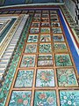 Colorful floral designs adorns the huge doors of the temple.jpg