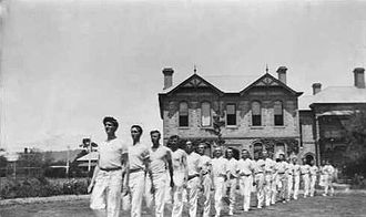 Concordia College (South Australia) - Gymnasium team in front of the main building, c.1921