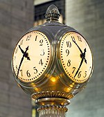 Large four-sided brass clock