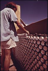 Construction of One of Three Experimental Houses Built from Empty Beer and Soft Drink Cans. (3815853328).jpg