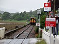 Corpach railway station, Mallaig Extension Line, Highlands. View north with train.jpg