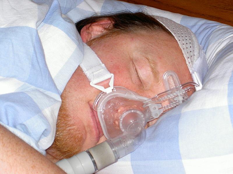man wearing sleep apnia mask