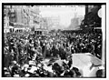 Crowd on Penn Ave. watching Suffrage parade LCCN2014691492.jpg