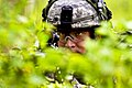 Defense.gov News Photo 110427-A-3108M-002 - Army Pfc. Dustin Dean provides security behind a machine gun while the rest of his platoon searches a farmhouse for intelligence during a platoon.jpg