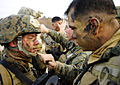 Defense.gov News Photo 120303-N-SD300-026 - Cpl. Mario Melendez right assigned to 2nd Platoon Company Pacific Fleet Anti-Terrorism Security Team applies camouflage paint to Lance Cpl.jpg