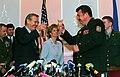 Donald Rumsfeld and Oleksandr Kuzmuk celebrate with a toast, 2001.jpg
