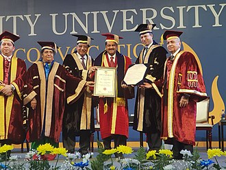 Founder President of Thumbay Group, Thumbay Moideen receiving the honorary doctorate from Founder President of Amity University - Dr. Ashok K. Chauhan, Chancellor - Dr. Atul Chauhan, Chairman of Amity PACIFIC Forum - Dr. Ajit Kumar Nagpal, and other officials. Dr. Thumbay Moideen.jpg