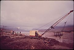 Dragline Scoops Oil - Laden Debris from Site of Clean - Up Operations Following Massive Oil Spill Into the San Juan River, 10-1972 (3814971812).jpg