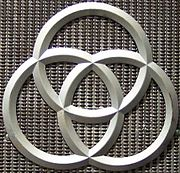 The three rings were the symbol for Krupp, based on the radreifen - the seamless railway wheels patented by Alfred Krupp. The rings are currently part of the ThyssenKrupp logotype.