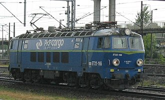 PKP class ET22 - ET22-165 from a left side, showing early configuration of air intakes. Headlights are modernized.
