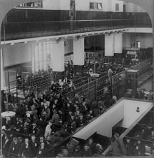Black and white photograph of a recent immigrants queuing in the Immigrant Building on Ellis Island, New York Harbor.