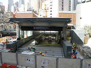 Entrance and exit A1 of Sai Ying Pun Station under construction in December 2014.JPG