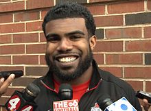 Ezekiel Elliott picture while being questioned by reporters in 2015 when he played for Ohio State
