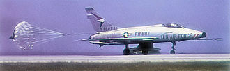 18th Wing - 18th TFW North American F-100A-15-NA Super Sabre Serial, AF Ser. No. 53-1587, landing at Kadena Air Base.