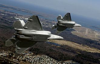 Virginia Peninsula - Two F-22A turn in on final approach to Langley Air Force Base